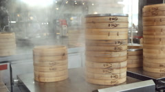 Bamboo steamers in kitchen Stock Footage