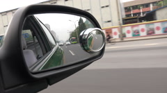 Mirror of a Chinese taxi driving through Beijing streets Stock Footage