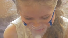 Kid is Looking Down Turns And Talking Sitting With Nebulizer Mask on Her Face Stock Footage