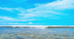 Clear summer sea landscape background. Ocean waves and blue sky at sunny day Stock Footage