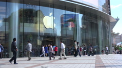 China consumption, people visit popular Apple store in Beijing shopping street - stock footage