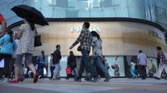 China consumption, pedestrians walk past Western designer label store Stock Footage