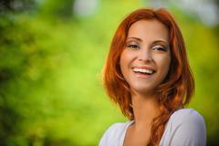 Portrait of redhead brunette Stock Photos