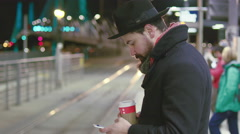 Stylish man uses phone while waiting for train to arrive and gets on the train. Stock Footage