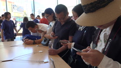 China middle class, domestic consumption, Apple store, shopping street Beijing - stock footage