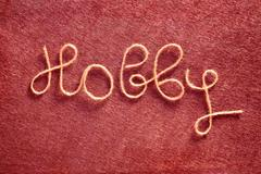 The Inscription Handmade Made of  Yarn on the Red Felt Fabric Background Text Stock Photos
