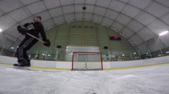 Gopro closeup of hockey player deflecting shots Stock Footage