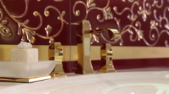 Gold faucet water in bathroom Stock Footage