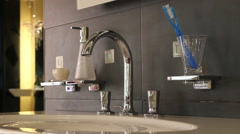 Silver faucet water in bathroom Stock Footage