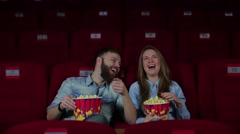 Guy and a girl laughing in the cinema - stock footage