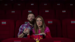 Boy and girl scared in the cinema - stock footage