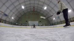 Gopro view of hockey players deflecting shots Stock Footage