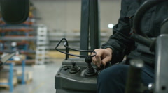 Portrait of a warehouse worker driving a forklift truck Stock Footage