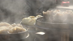 China street food, small restaurant, cooking fresh dumplings, steam, sunlight - stock footage