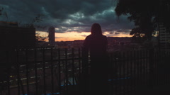 Cinematic Medium Handheld Shot of a Woman watching the Sunset Stock Footage