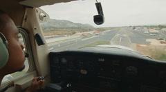 Pilot landing small plane Stock Footage