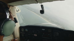 Pilot banking a turn over water Stock Footage