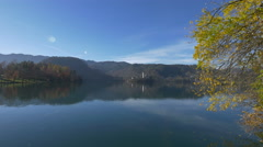 Pilgrimage Church seen from across the lake in Bled - stock footage