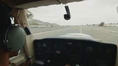 Pilot taking off small plane Stock Footage