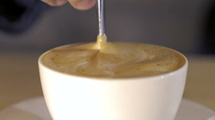 Close up of a cup of coffee in which mixing the tasty foam. Slowly Stock Footage