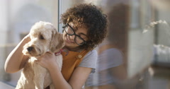4K Portrait of young woman relaxing at home with cute pet dog Stock Footage