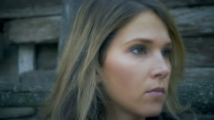 Close up of beautiful woman standing still, camera moving around her face - stock footage