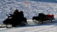 People drive snowmobiles near the town of Longyearbyen, Norway. Stock Footage
