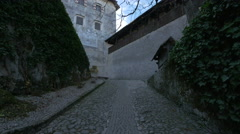 Old cobblestone alley in Bled Castle's courtyard Stock Footage
