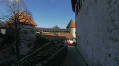 Narrow alley near the Bled Castle's towers Stock Footage