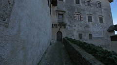 Alley leading to an old door at Bled Castle - stock footage