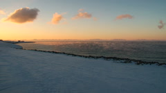 View to the cabins at the arctic sea shore of Spitsbergen at sunset. - stock footage