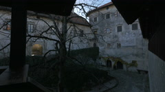 Bled Castle's old buildings and trees seen from a balcony Stock Footage
