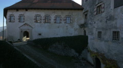Old buildings and cobblestone alley in Bled Castle's courtyard Stock Footage