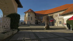 The beautiful Bled Castle's courtyard with old building and red roofs Stock Footage