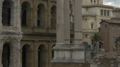 Ruins of Roman columns and old building with arches in Rome - stock footage