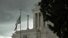 Italian flag waving in front of Altare della Patria in Rome Stock Footage