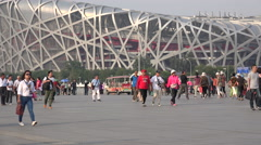 Chinese tourists visit the Bird's Nest stadium, center of 2008 Beijing Olympics Stock Footage