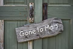 Gone to Mars planet sign on old green doors. - stock photo