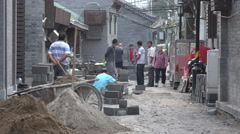 China Beijing hutong renovation, local residents walk through narrow alleys - stock footage