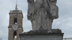 Headless sculpture and the tower of Comune di Roma Palazzo Senatorio, Rome - stock footage