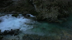 The foamy water of Emerald River at the Vintgar Canyon, near Bled Stock Footage