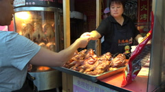 People stand in line to buy the popular Beijing roast duck in China Stock Footage