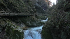 Wooden path next to a waterfall on Radovna River, near Bled Stock Footage