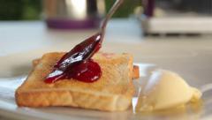 Jam spread on toasts Stock Footage