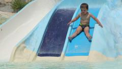 Boy ride the roller coaster in the pool Stock Footage