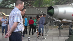 Chinese men look at fighter jet planes at military museum in Beijing - stock footage