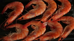 Cooking shrimp on the grill - stock footage