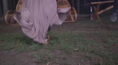 Young girl in a fashionable long dress provocatively dancing to lively music - stock footage