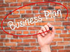 Man Hand writing  Business Plan with black marker on visual screen - stock photo