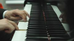 Close up hands playing the piano Stock Footage